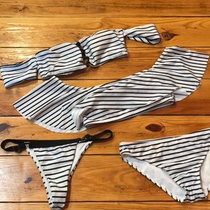 Black and White striped medium swim suit pieces